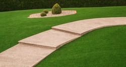Front yard with garden path and outside staircase made of granite and artificial turf