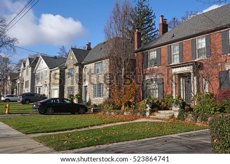 front yards and driveways of street with suburban houses #523864741