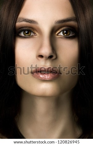 frontal close-up portrait of young ethnic woman
