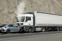 Frontal impact between a car and a truck. Car accident.