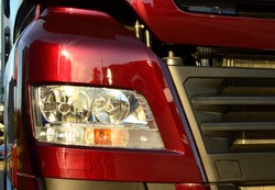 Frontal lighting products for on-highway vehicles, which includes integrated daytime running lights and beam patterns. Bi-Xenon and halogen headlamp of a modern truck, background texture - Image