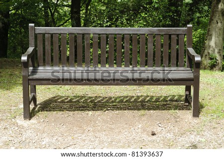 Frontal View Of A Wooden Empty Bench In A Park Ez Canvas