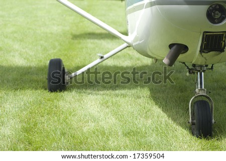 Frontal view of an airplane grounded on the grass