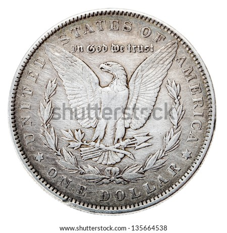 Frontal view of the obverse (heads) side of a silver dollar minted in 1883, known by the name 'Morgan Dollar'. Depicted is an eagle with wings outstretched Isolated on white background.