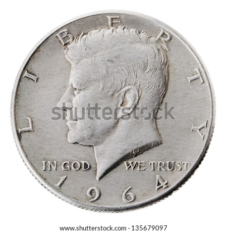 Frontal view of the obverse (heads) side of a silver half Dollar minted in 1964.Depicted is a profile portrait of John F. Kennedy and comes to honor his memory. Isolated on white background.
