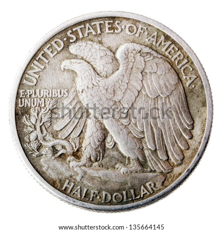 Frontal view of the reverse (tails) side of a silver half Dollar minted in 1942. Depicted is a bald eagle rising from a mountaintop perch. Isolated on white background.