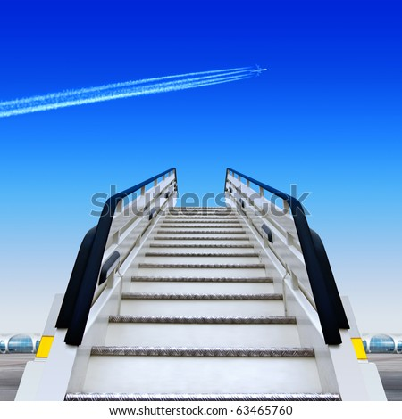 frontal view of white ramp in airport and fly away plane - stock photo