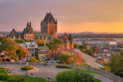 Frontenac Castle in Old Quebec City in the beautiful sunrise light. High dynamic range image. Travel, vacation, history, cityscape, nature, summer, hotels and architecture concept