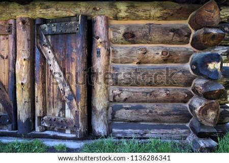 frontier log cabin.  front door ...