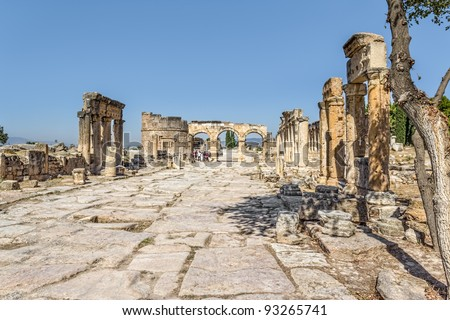 Frontinus street, the main thoroughfare and Fortinus gate at the end. Roman time city Hierapolis, Pamukkale, Turkey.