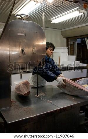 Fronze Tuna cutting at Tokyo fish market - Tsukiji - stock photo