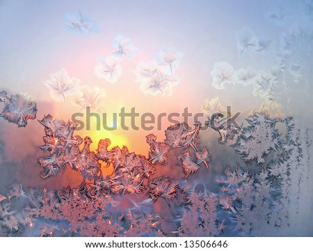 Frost and sun on morning winter window