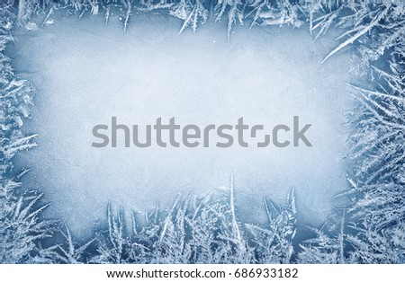 Frost crystal border on ice - Christmas background #686933182