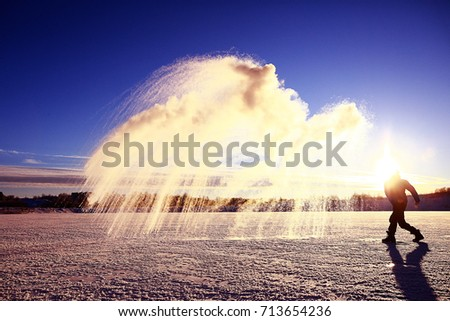 frost effect hot water freezes man pours boiling water #713654236