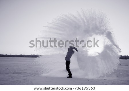 frost effect hot water freezes man pours boiling water #736195363