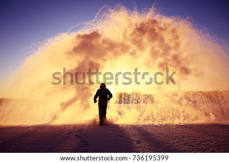 frost effect hot water freezes man pours boiling water #736195399