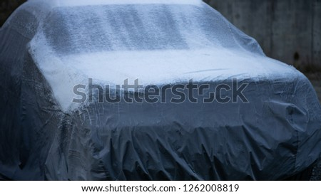 Frost is covering the vehicle protection cover. #1262008819