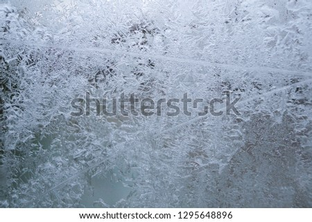 Frost on transparant glass during the wintertime  #1295648896