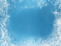 Frost patterns on frozen window as a symbol of Christmas wonder. Christmas or New year background.