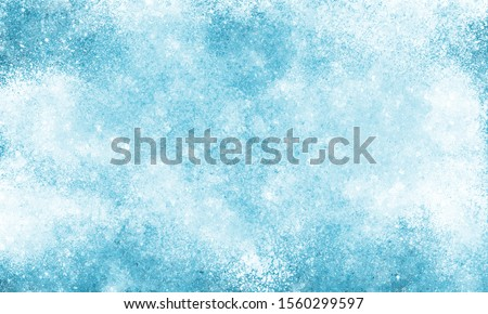 Frost texture iced surface, Winter material.  Abstract frosty pattern on glass. frosted glass texture. Blue foil freeze gradient texture background. The frozen water. Winter and Snow background.