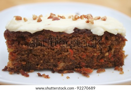 Frosted Carrot Cake Slice on a White Plate