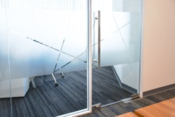 Frosted film glass sticker cut in pattern, Glass Film Design, Privacy in work place, Modern office meeting room or manager room concept. Glass wall idea for interior.