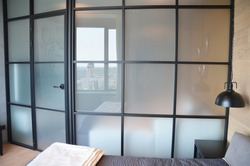 Frosted glass bedroom wall, glass room divider, partition with squares is a perfect solution for small spaces.