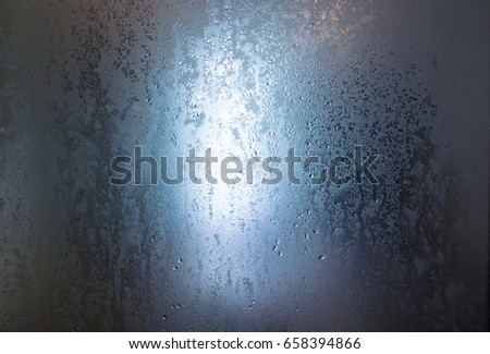 Frosted glass texture was covered by drop of water #658394866