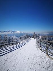 Frosty day at the ski resort. Poiana Brasov. People practicing ski in Poiana Brasov, Romania