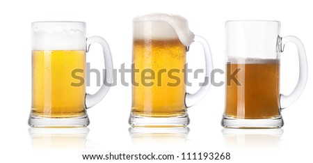 Frosty fresh beer set with foam isolated on a white background