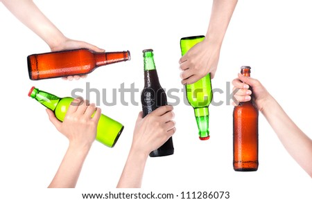Frosty fresh bottle of beer in a hand set  isolated. making toast on a white background