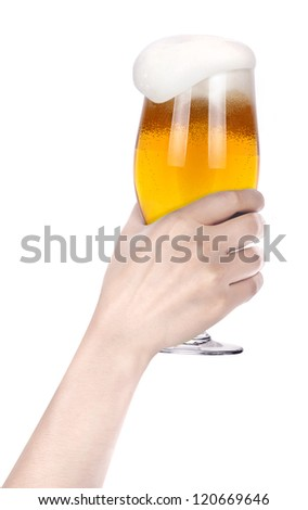 Frosty glass of beer with hand.making toast