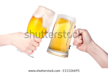 Frosty glass of beer with hand.making toast isolated on a white background