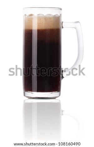 Frosty glass of dark beer with foam and water drops isolated on a white background