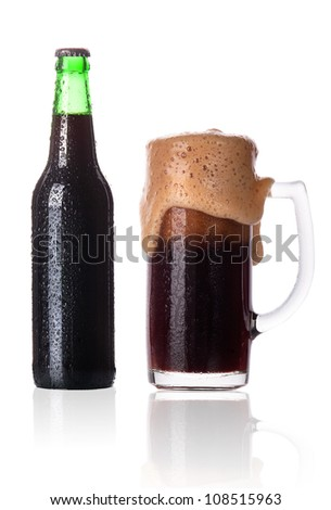 Frosty glass of dark beer with foam isolated on a white background