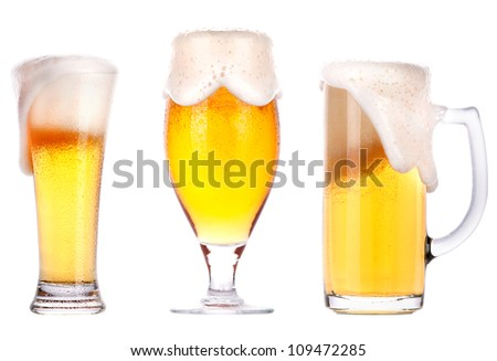 Frosty glass of light beer isolated on a white background. - stock photo