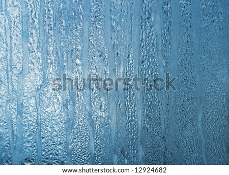 frosty natural pattern on winter window. frost abstract background.