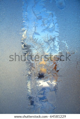 Frosty original  pattern at a winter window glass, natural texture
