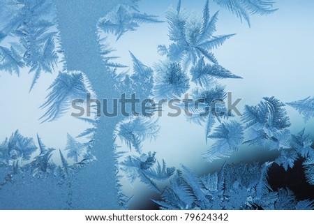 Frosty original  pattern at a winter window glass, natural texture