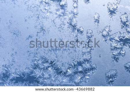 Frosty pattern on window in winter season