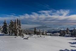 Frosty sunrise at Vitosha mountain, Sofia, Bulgaria - beautiful winter landscape - first rays of sunlight over the fresh snow powder.