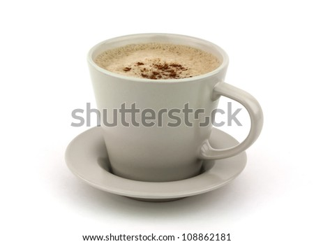 Frothy cappuccino coffee in cup with saucer isolated on white background with copy space. - stock photo