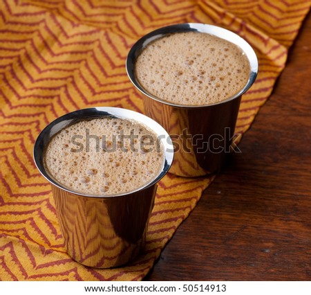 Frothy South Indian coffee served in steel glasses