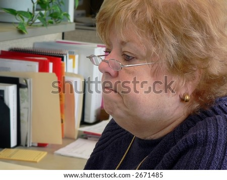 Frowning woman in office