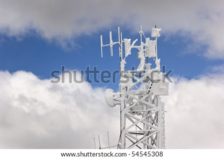 Frozen antenna over a cloudy sky