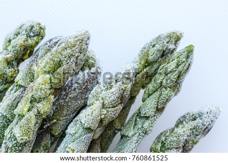 frozen asparagus on white cutting board, top view, macro #760861525