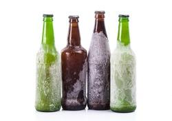 Frozen beer bottles on white isolated background