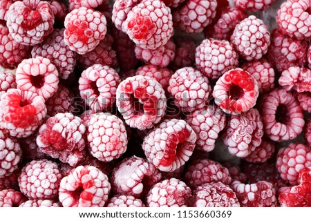 Frozen berries of raspberries, covered with hoarfrost. Close-up. #1153660369
