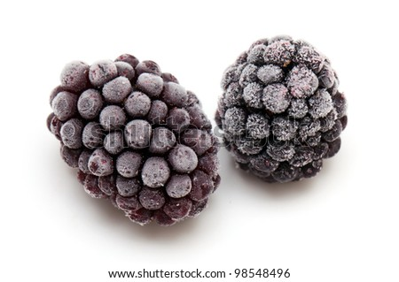 frozen blackberries isolated on white background