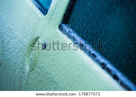 Frozen car door in winter